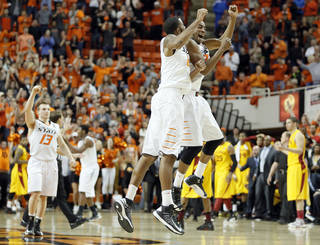 Oklahoma State's Phil Forte (13), Michael Cobbins (20) and Markel Brown (22) react in the final seconds of the win over Iowa State during the college basketball game between the Oklahoma State University Cowboys (OSU) and the Iowa State University Cyclones (ISU) at Gallagher-Iba Arena on Wednesday, Jan. 30, 2013, in Stillwater, Okla. Photo by Chris Landsberger, The Oklahoman