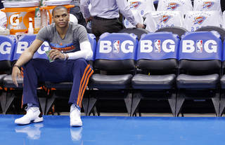 NBA BASKETBALL: Russell Westbrook sits on the bench before the start of Game 2 in the first round of the NBA playoffs between the Oklahoma City Thunder and the Houston Rockets at Chesapeake Energy Arena in Oklahoma City, Wednesday, April 24, 2013. Photo by Chris Landsberger, The Oklahoman