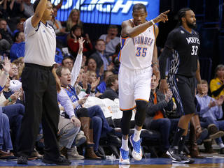 Oklahoma City's Kevin Durant (35) reacts beside Minnesota's Ronny Turiaf (32) after making a basket during an NBA basketball game between the Oklahoma CIty Thunder and the Minnesota Timberwolves at Chesapeake Energy Arena in Oklahoma City, Wednesday, Feb. 5, 2014. Oklahoma City won 106-97. Photo by Bryan Terry, The Oklahoman