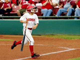 Casey Angle, sister of Moore tornado victim Sydney Angle performs as bat girl during the NCAA Super Regional softball game as the University of Oklahoma (OU) Sooners defeats Texas A&M 10-2 at Marita Hines Field on Friday, May 24, 2013 in Norman, Okla. Photo by Steve Sisney, The Oklahoman