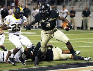 Broken Arrow's Devon Thomas (right) breaks away from Myron Patrick into the end zone during a 6A playoff football game against Sand Springs at Broken Arrow High School on Friday, November 9, 2012. MATT BARNARD/Tulsa World
