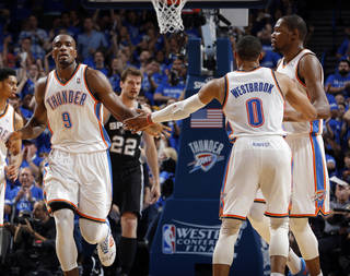 Oklahoma City's Serge Ibaka (9) celebrates with Russell Westbrook (0) and Kevin Durant (35) during Game 3 of the Western Conference Finals in the NBA playoffs between the Oklahoma City Thunder and the San Antonio Spurs at Chesapeake Energy Arena in Oklahoma City, Sunday, May 25, 2014. Photo by Bryan Terry, The Oklahoman