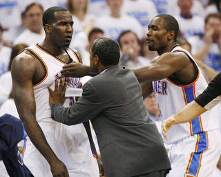 Oklahoma City's Serge Ibaka (9) and assistant coach Maurice Cheeks hold back Kendrick Perkins (5) from Dirk Nowitzki of Dallas during Game 2 of the first round in the NBA basketball playoffs between the Oklahoma City Thunder and the Dallas Mavericks at Chesapeake Energy Arena in Oklahoma City, Monday, April 30, 2012. Photo by Nate Billings, The Oklahoman