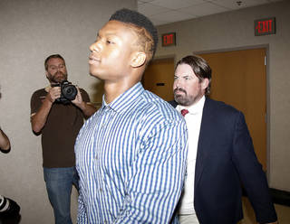 University of Oklahoma freshman Joe Mixon and his attorneys walk into Judge Steve Stice's courtroom in Cleveland County in Norman, Monday August 18, 2014. Steve Gooch - The Oklahoman