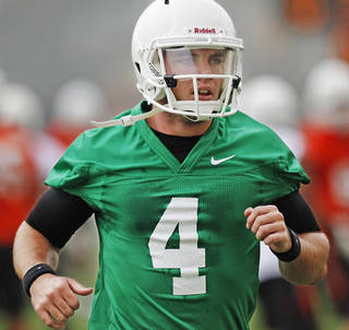 Oklahoma State quarterback J.W. Walsh (4) runs during the first team practice of the fall at the Sherman E. Smith Training Facility on the campus of Oklahoma State University in Stillwater on August 1, 2014. Photo by KT King, The Oklahoman