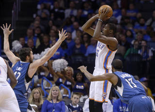 Oklahoma City Thunder forward Kevin Durant (35) shoots over Minnesota Timberwolves forward Kevin Love (42) and guard Alexey Shved (13) in the first quarter of an NBA basketball game in Oklahoma City, Sunday, Dec. 1, 2013. (AP Photo/Sue Ogrocki)