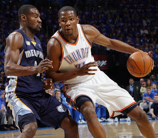 OKLAHOMA CITY ARENA / PLAYOFFS: Oklahoma City's Kevin Durant (35) tries to get the ball past Tony Allen (9) of Memphis in the first half during game 7 of the NBA basketball Western Conference semifinals between the Memphis Grizzlies and the Oklahoma City Thunder at the OKC Arena in Oklahoma City, Sunday, May 15, 2011. Photo by Nate Billings, The Oklahoman ORG XMIT: KOD