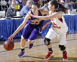 Anadarko's Lakota Beatty (23) drives past Ft. Gibson's Jodi Glover (14) during a 4A girls state basketball championship game at State Fair Arena on Saturday, March 10, 2012, in Oklahoma City, Okla. (AP Photo/The Oklahoman, Chris Landsberger) ORG XMIT: OKOKL204