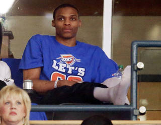 Injured Oklahoma City guard Russell Westbrook (0) watches from a suite during Game 5 in the first round of the NBA playoffs between the Oklahoma City Thunder and the Houston Rockets at Chesapeake Energy Arena in Oklahoma City, Wednesday, May 1, 2013. Photo by Nate Billings, The Oklahoman