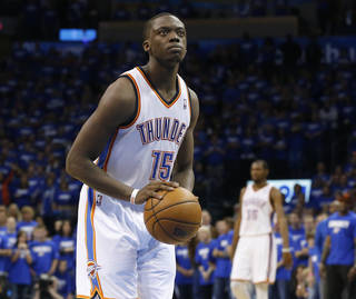 Oklahoma City Thunder guard Reggie Jackson (15) shoots a free throw late in the fourth quarter of Game 1 of their Western Conference semifinal NBA basketball playoff series against the Memphis Grizzlies in Oklahoma City, Sunday, May 5, 2013. Oklahoma City won 93-91. (AP Photo/Sue Ogrocki)