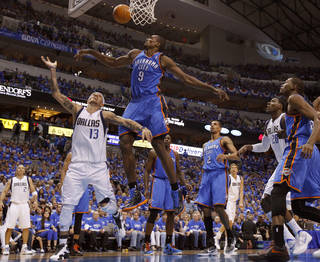 Oklahoma City's Serge Ibaka (9) defends Dallas' Delonte West (13). during Game 3 of the first round in the NBA playoffs between the Oklahoma City Thunder and the Dallas Mavericks at American Airlines Center in Dallas, Thursday, May 3, 2012. Photo by Bryan Terry, The Oklahoman