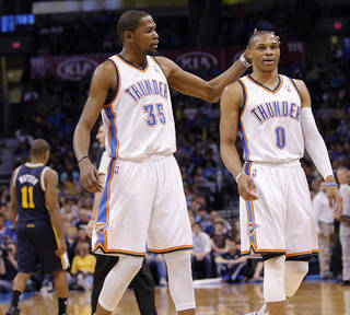 Oklahoma City Thunder's Kevin Durant (35) pats Oklahoma City Thunder's Russell Westbrook (0) on the head as they walk off the court during the NBA basketball game between the Oklahoma City Thunder and the Utah Jazz at Chesapeake Energy Arena on Wednesday, March 13, 2013, in Oklahoma City, Okla. Photo by Chris Landsberger, The Oklahoman