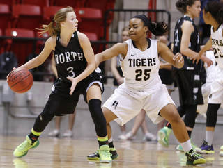 Broken Arrow's Tierra Jones, right, guards Norman North's Paige Canty during the class 6A girls state basketball tournament at Skiatook.