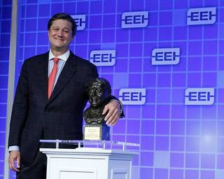 OGE Energy Corp. CEO Pete Delaney stands with the Edison Award given Monday to Oklahoma Gas and Electric Co. at the Edison Electric Institute's annual convention in San Francisco. It is the electric industry's most prestigious honor. Paul Sakuma - Paul Sakuma Photography