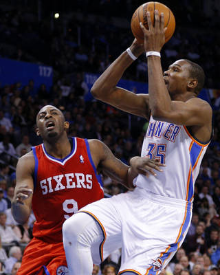 Oklahoma City's Kevin Durant (35) shoots over Philadelphia's James Anderson (9) during an NBA basketball game between the Oklahoma City Thunder and the Philadelphia 76ers at Chesapeake Energy Arena in Oklahoma City, Tuesday, March 4, 2014. Oklahoma City won 125-92. Photo by Bryan Terry, The Oklahoman