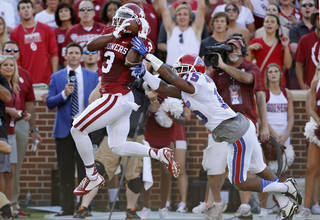 Oklahoma wide receiver Sterling Shepard (3) catches a pass for a touchdown in front of Louisiana Tech cornerback Bryson Abraham (15) in the first quarter of an NCAA college football game in Norman, Okla., Saturday, Aug. 30, 2014. (AP Photo/Sue Ogrocki)