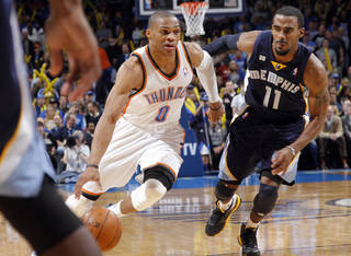 Oklahoma City's Russell Westbrook (0) drive past Memphis' Mike Conley Jr. (11) during the NBA basketball game between the Oklahoma City Thunder and the Memphis Grizzlies at Chesapeake Energy Arena on Wednesday, Nov. 14, 2012, in Oklahoma City, Okla. Photo by Chris Landsberger, The Oklahoman