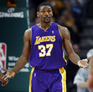 Los Angeles Lakers forward Metta World Peace, shown here in a 2011 game, was suspended seven games by the NBA for his elbow on the Oklahoma City Thunder's James Harden. AP PHOTO David Zalubowski