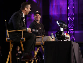 San Francisco 49ers head coach Jim Harbaugh and Baltimore Ravens head coach John Harbaugh participate in a news conference for the NFL Super Bowl XLVII football game Friday, Feb. 1, 2013, in New Orleans. (AP Photo/Mark Humphrey)