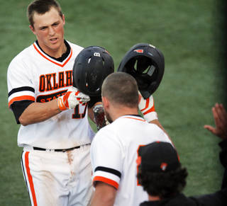 Oklahoma State base runner Gage Green (17) is congratulated as he returns to the bench after hitting a home run during a NCAA college baseball game between Oklahoma State University (OSU) and Arizona State University at Allie P. Reynolds stadium in Stillwater, Okla., Friday, May 2, 2014. Photo by KT King, The Oklahoman