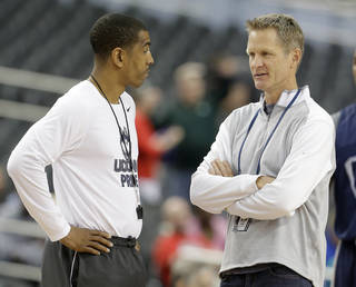 TNT analyst Steve Kerr talks with Connecticut coach Kevin Ollie in a practice before the Final Four. AP Photo Eric Gay - AP