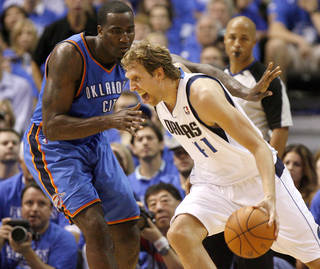 Dallas' Dirk Nowitzki (41) goes past Oklahoma City's Kendrick Perkins (5) during Game 3 of the first round in the NBA playoffs between the Oklahoma City Thunder and the Dallas Mavericks at American Airlines Center in Dallas, Thursday, May 3, 2012. Photo by Bryan Terry, The Oklahoman