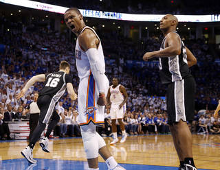 Oklahoma City's Russell Westbrook (0) celebrates a dunk in front of San Antonio's Boris Diaw (33) during Game 4 of the Western Conference Finals in the NBA playoffs between the Oklahoma City Thunder and the San Antonio Spurs at Chesapeake Energy Arena in Oklahoma City, Tuesday, May 27, 2014. Photo by Nate Billings, The Oklahoman
