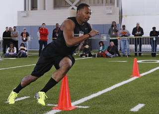 Oklahoma State cornerback Justin Gilbert participates in a drill during Oklahoma State's pro day for NFL scouts in Stillwater, Okla., Thursday, March 13, 2014. (AP Photo/Sue Ogrocki)