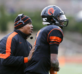 Douglass Coach Willis Alexander, left, was not happy with the officiating in his team's Class 4A semifinal loss. Photo by Jim Beckel, The Oklahoman