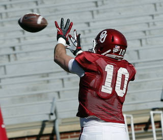 Blake Bell (10) goes through drills as the University of Oklahoma Sooners (OU) begin spring practice on Owen Field at Gaylord Family-Oklahoma Memorial Stadium in Norman, Okla., on Tuesday, March 11, 2014. Photo by Steve Sisney, The Oklahoman