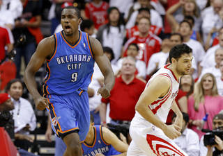 Oklahoma City's Serge Ibaka (9) reacts next to Houston's Carlos Delfino (10) during Game 3 in the first round of the NBA playoffs between the Oklahoma City Thunder and the Houston Rockets at the Toyota Center in Houston, Texas, Sat., April 27, 2013. Oklahoma City 104-101. Photo by Bryan Terry, The Oklahoman