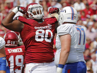 TULSA GOLDEN HURRICANE: Oklahoma's Jordan Phillips (80) reacts to a stop in front of Tulsa 's Jake Alexander (77) during the college football game between the University of Oklahoma Sooners (OU) and the University of Tulsa Hurricane (TU) at the Gaylord Family-Oklahoma Memorial Stadium on Saturday, Sept. 14, 2013 in Norman, Okla. Photo by Chris Landsberger, The Oklahoman