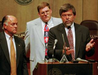 Former Mayor Ron Norick (left) and Clay Bennett (center) listen to Rick Horrow of Horrow Sports Ventures talk about the attempts of a private citizens' group to attract an NHL or NBA franchise at a 1995 press conference. ROGER KLOCK