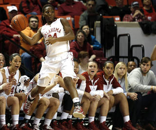 Oklahoma guard Sharane Campbell (24) saves a ball from out of bounds during the women's basketball game between, University of Oklahoma and West Virginia, Thursday, Feb. 13, 2014, in Norman, Okla. Photo by Sarah Phipps, The Oklahoman