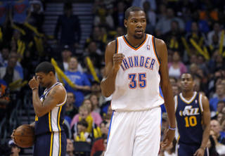 Oklahoma City's Kevin Durant (35) celebrates in front of Utah's Earl Watson and Alec Burks (10) during the NBA game between the Oklahoma City and the Utah Jazz and the Chesapeake Energy Arena, Friday,Nov. 30, 2012. Photo by Sarah Phipps, The Oklahoman
