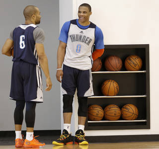 Derek Fisher, left, and Russell Westbrook talk during a Thunder practice on Wednesday. Westbrook participated in his first full practice Wednesday, according to Thunder coach Scott Brooks, and is now believed to be a game-time decision for Thursday's game against Miami. Photo by Doug Hoke, The Oklahoman
