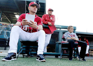 OU coach Pete Hughes and assistant Mike Anderson watch the action. PHOTO PROVIDED BY OU SPORTS INFORMATION