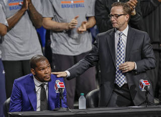 Coach Scott Brooks pats Kevin Durant on the shoulder as Durant gets emotional during a news conference announcing Oklahoma City Thunder's Kevin Durant as the winner of the 2013-14 Kia NBA Basketball Most Value Player Award in Oklahoma City, Okla. on Tuesday, May 6, 2014. Photo by Chris Landsberger, The Oklahoman