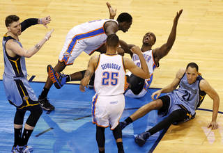 Memphis' Mike Miller (13) signals for no basket as Oklahoma City's Serge Ibaka (9), Reggie Jackson (15) and Thabo Sefolosha (25) celebrate a possible game-wining shot by Ibaka at the end of overtime near Memphis' Tayshaun Prince (21) during Game 5 in the first round of the NBA playoffs between the Oklahoma City Thunder and the Memphis Grizzlies at Chesapeake Energy Arena in Oklahoma City, Tuesday, April 29, 2014. Instant replay showed Ibaka's shot came after the buzzer. Memphis won 100-99 in overtime. Photo by Nate Billings, The Oklahoman