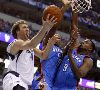 Dallas' Dirk Nowitzki (41) goes to the basket beside Oklahoma City's Serge Ibaka (9) and Nazr Mohammed (8) during Game 4 of the first round in the NBA playoffs between the Oklahoma City Thunder and the Dallas Mavericks at American Airlines Center in Dallas, Saturday, May 5, 2012. Oklahoma City won 103-97. Photo by Bryan Terry, The Oklahoman