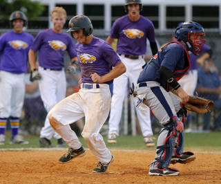 Red Oak's Bryce Deatherage scores past Asher's Phillip Leon in the third inning Garrett Noah of the Class B state baseball championship game at Dolese Park in Warr Acres, Okla., Saturday, May 10, 2014. Photo by Bryan Terry, The Oklahoman