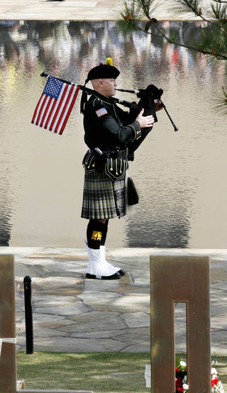 Pipe Sgt. Kevin M. Donnelly plays for the 15th anniversary of the Oklahoma City bombing. PHOTO BY PAUL B. SOUTHERLAND, THE OKLAHOMAN ARCHIVES