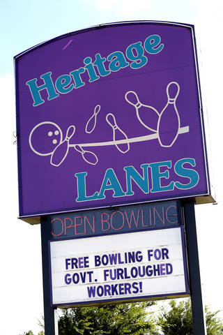Sign at Heritage Lanes, 11917 N Pennsylvania Ave, Oklahoma City, offering free bowling for furloughed government workers Saturday, October 12, 2013. Photo by Doug Hoke, The Oklahoman