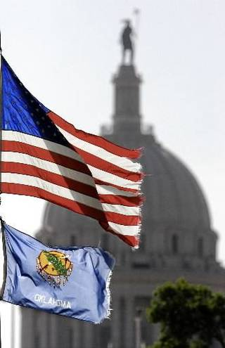 Flags fly in front of the state Capitol in this 2008 photo by Jim Beckel.
