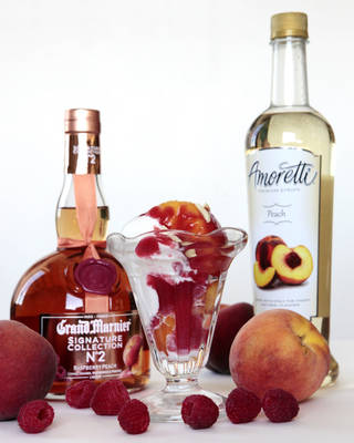Sherrel uses cognac to make Peach Melba. PHOTO BY DAVID MCDANIEL, THE OKLAHOMAN David McDaniel