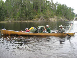 Declan Lawson, Tyler Cotner and Dean Kelley turn around the 23-foot canoe with all of their gear. Most of the Boundary Waters Canoe Area Wilderness in northern Minnesota can only be reached by hiking or by paddling and portage. Photo by Jim Lawson