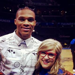 OKLAHOMA CITY THUNDER CARES / NBA BASKETBALL TEAM: Lorelei Decker wears lens-less frames during a visit with Thunder point guard Russell Westbrook. Photo provided