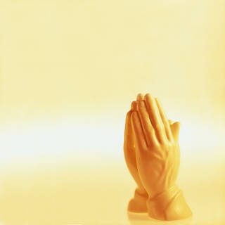 Praying hands statue