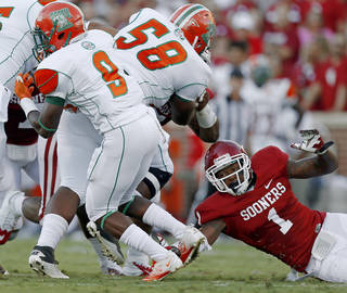 Oklahoma's Tony Jefferson (1) tries to bring down Florida A&M's Eddie Rocker (9) during the college football game between the University of Oklahoma Sooners (OU) and Florida A&M Rattlers at Gaylord Family-Oklahoma Memorial Stadium in Norman, Okla., Saturday, Sept. 8, 2012. Photo by Bryan Terry, The Oklahoman