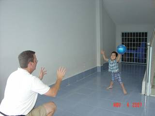 Austin Evans, then 3, plays ball with his new adoptive father Bill Evans at the ophanage in the Vihn Long Province of Vietnam where the boy lived the first few years of his life. Austin. Austin says his only real memory of being at the orphanage is of playing with a ball in his room. Austin is now 8 and raises money to send kids from that area to school. Photo provided.